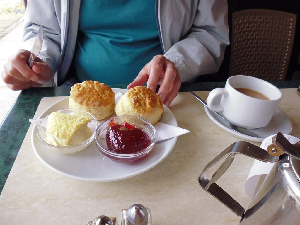 Enjoy a cream tea in the summer in Tiverton, Devon, UK.