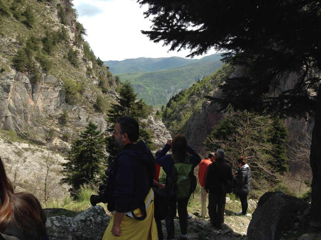 The travel bloggers hiking down to the waterfalls and stopping en-route to admire the scenery