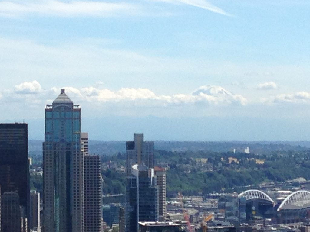 Can you see Mount Rainer in the background, pocking her head up about the clouds?