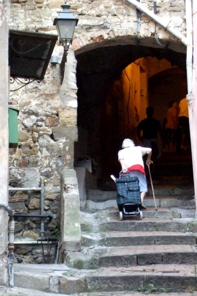 Old lady climbing the stairs in San Remo