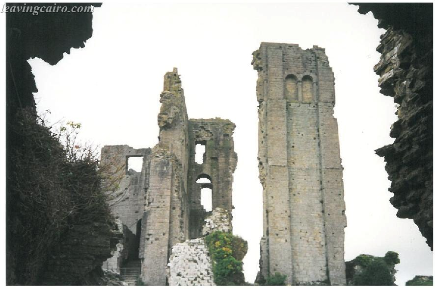 Corfe Castle Ruins rising from the grounds - LifeBeyondBorders