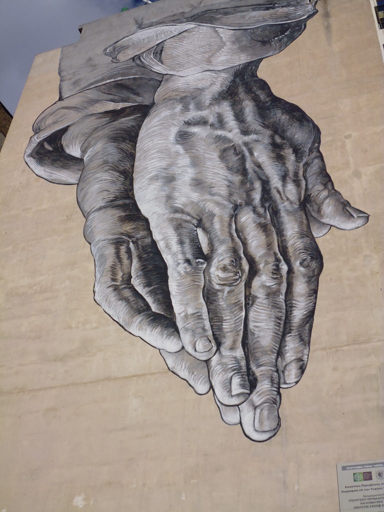 Praying Hands streetart in Pireos St, Athens
