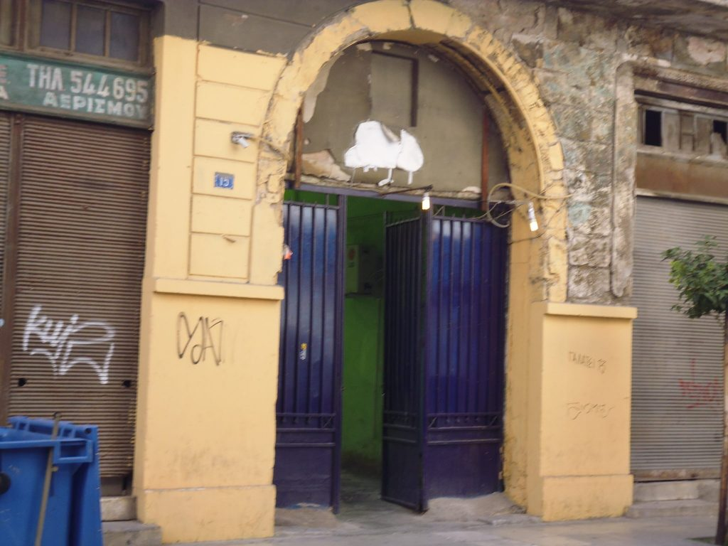 It may look like a nice doorway - it is, in fact, an entry to a brothel! Streetart tour - Athens