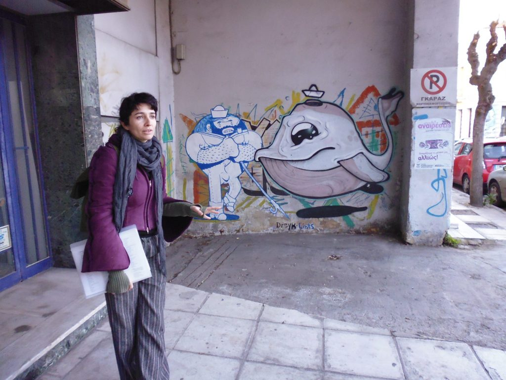 Metaxourgeio Streetart - Athens. Maria, our guide, in action. By Dreyk the Pirate and Lints