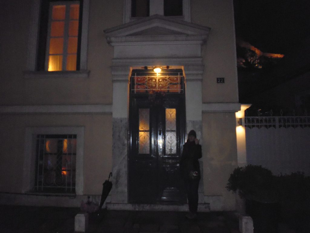Outside the 19th Century neo-classical home - with the Acropolis rock in the background