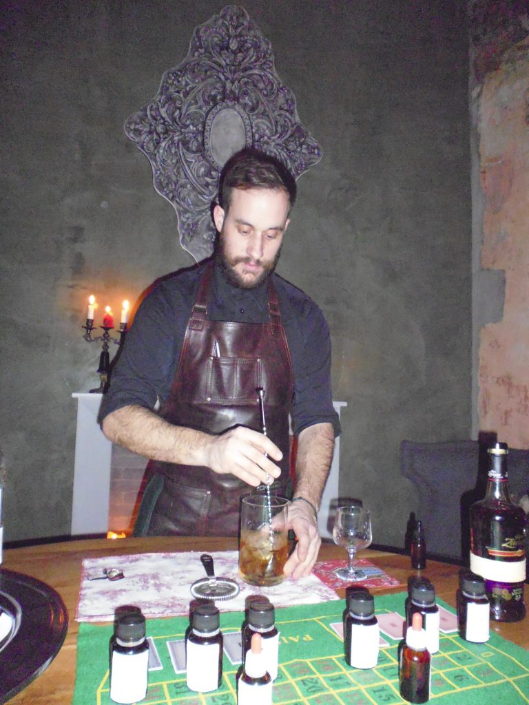 """Bartender Nikos at The Clumsies attending to our cocktail needs in """"The Room"""""""