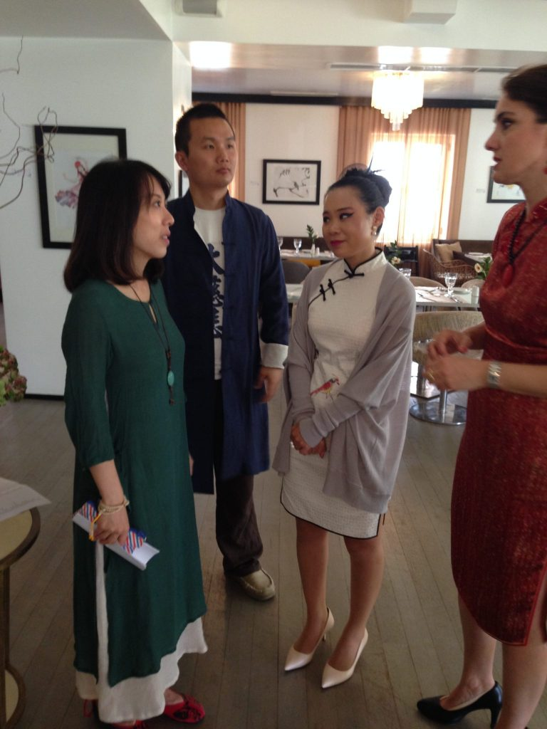 Kevin, Eley and artist Qinghua (Ioanna) together with Grecotel management