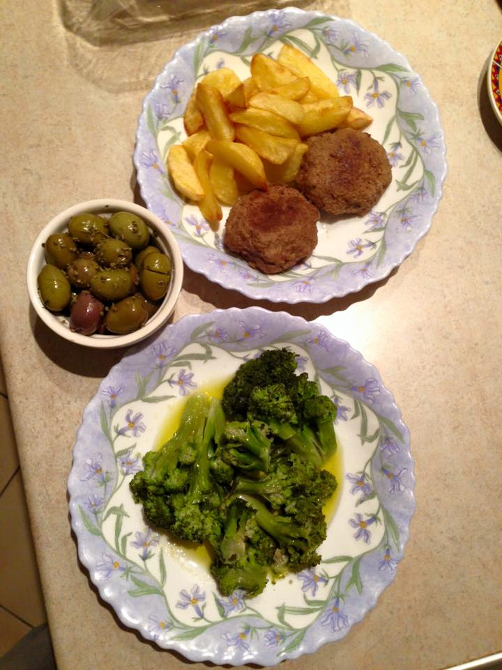 Homemade meatballs and homemade fries with broccoli in lemon and olive oil - and olives 'from the village'