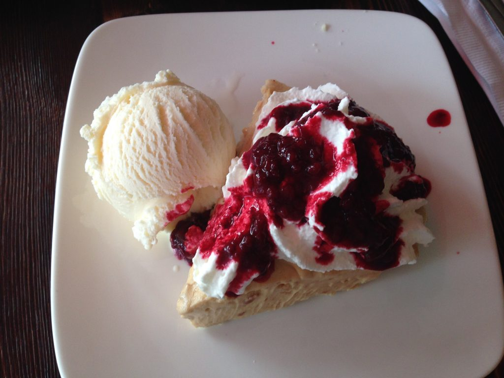 Peanut butter pie with raspberry compote, cream and ice cream