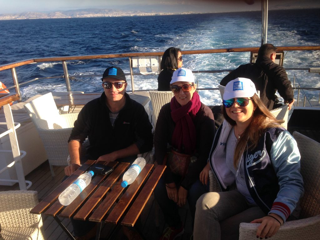 Travel Bloggers Greece relaxing on the top deck of Olympic Cruises