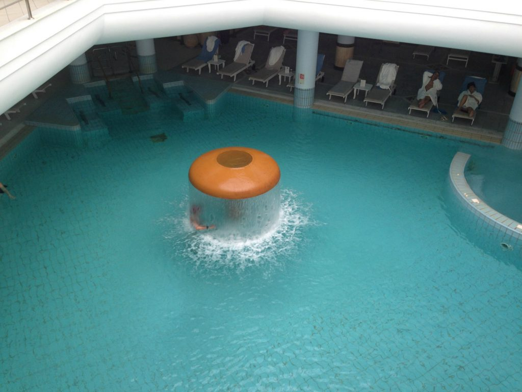 Indoor pool with flowing thermal waters at Thermae Sylla Spa Hotel - Evia