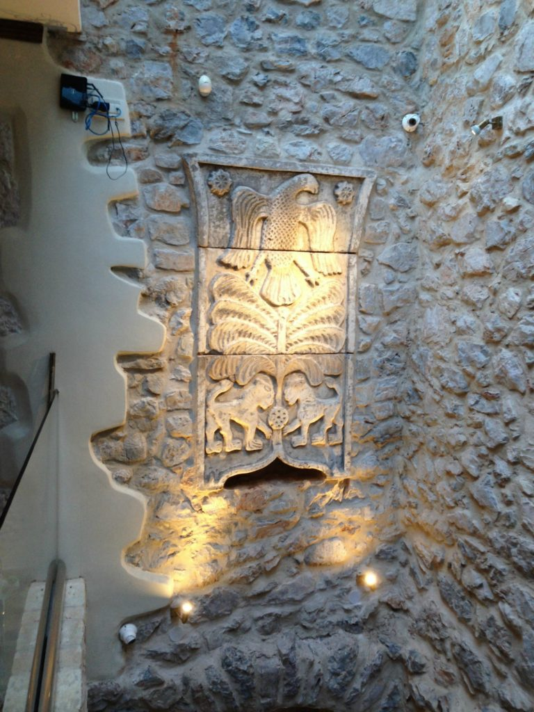 Family crest in the entranceway of Villa Vager