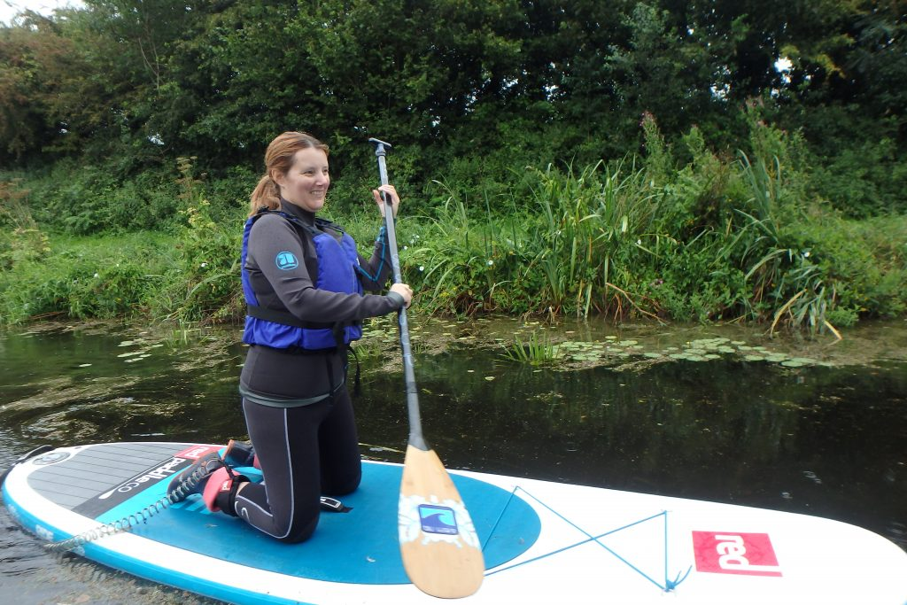 Kneeling on the Paddle board with Rob McPaddle Boarding - Grand Western Canal - Tiverton