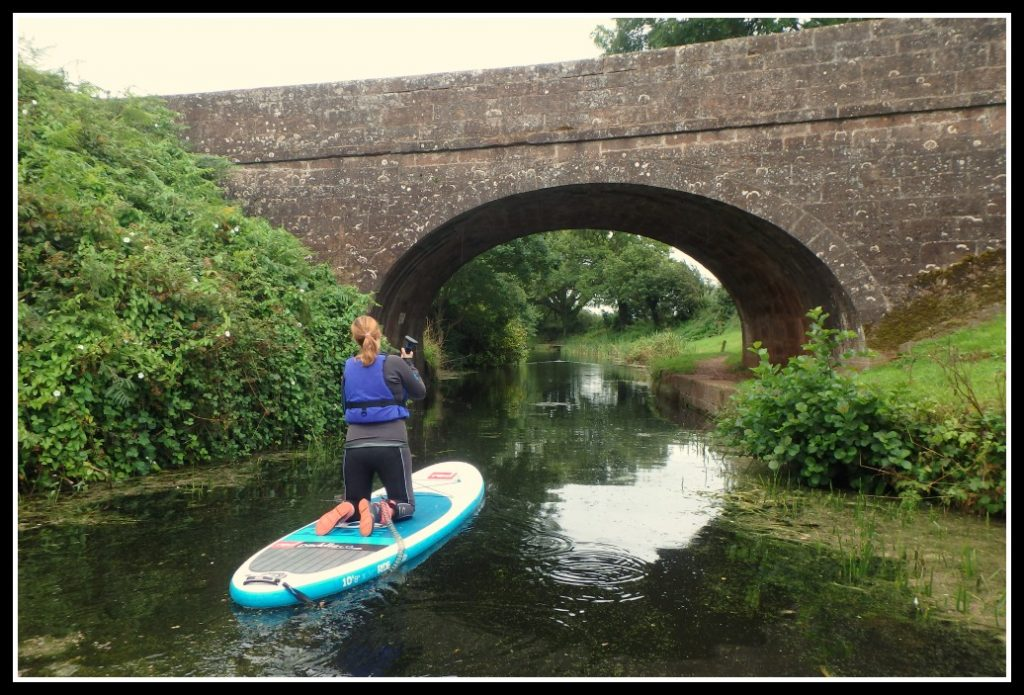 Paddle Boarding along the Grand Western Canal in Devon, UK