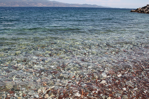 Stony beach on Hydra island - Greece. Life Beyond Borders